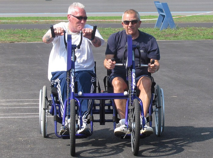Two-males-with-visual-impairments-using-side-by-side-handcyclesWfWCopyright